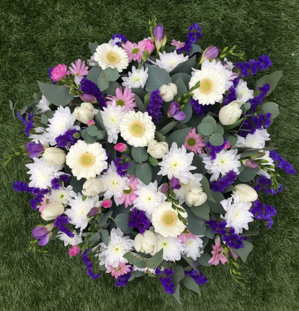 Large Funeral Posy Pad Tulips And Holly Florist