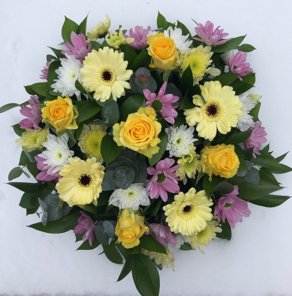 Funeral Posy Yellowpurple Tulips And Holly Florist